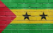 Flag of Sao Tome and Principe painted onto a grunge brick wall