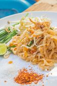 foto of egg noodles  - Noodles pad Thai is a thin rice noodles fried with tofu - JPG