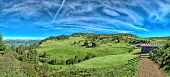 Italian mountain panorama in Tyrol with chalet, dairy cows and green pastures on a sunny day. HDR im