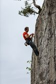 GORGES DU DAILLEY, SWITZERLAND - MAY 10: Rock climber prepares for descent in Gorges du Dailley on M