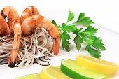Fresh unshelled boiled shrimps with spaghetti.