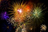 foto of firework display  - Colorful fireworks over dark sky during a celebration - JPG