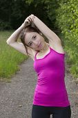 Smiling Young Woman Stretching Outdoors