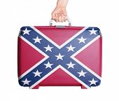 stock photo of flag confederate  - Used plastic suitcase with stains and scratches printed with flag Confederate flag - JPG