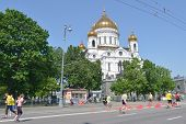 MOSCOW, RUSSIA - MAY 18, 2014: Runners on the distance of Moscow Half Marathon against the Cathedral