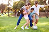 image of mums  - Family Playing Soccer In Park Together - JPG