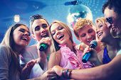 foto of singing  - Portrait of joyous guys and girls singing at party together - JPG