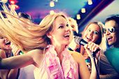 Portrait of joyous girl singing at party on background of happy friends