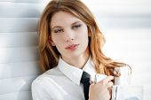 pic of button down shirt  - woman in a white button down shirt with tie - JPG