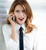 Beautiful young business woman talking on the phone