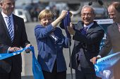 BERLIN, GERMANY - MAY 20, 2014: German Chancellor Angela Merkel, Turkish Minister of transport Lutfi