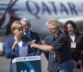 BERLIN, GERMANY - MAY 20, 2014: German Chancellor Angela Merkel (L) open up the International aviati