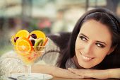 Young Woman with Fruit Salad Dessert