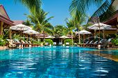 beautiful swimming pool in tropical resort , Phuket, Thailand.