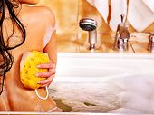 stock photo of bath sponge  - Young woman take bubble  bath - JPG