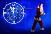 Santa Claus pulling arrow of clock with rope