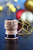 Champagne cork on Christmas lights background