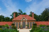 stock photo of slave-house  - Beautiful red brick design of the garden building at George Washington - JPG