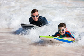 picture of boogie board  - Father and son surfing on boogie boards - JPG