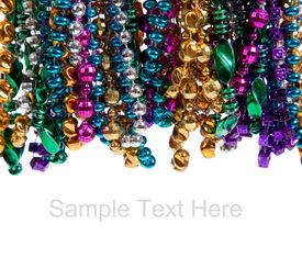 image of mardi-gras  - Multi colored mardi gras beads including blue green purple pink yellow and gold on a white background with copy space - JPG