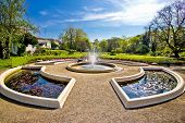 stock photo of fountain grass  - Fountain and park in Zagreb capital of Croatia - JPG