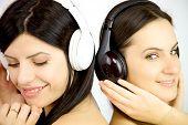 Two Women Enjoying Music Happy