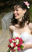 Bride Laughing with Veil and Bouquet