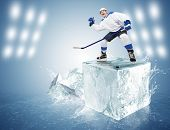 Hockey player on the ice cube
