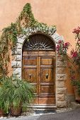Front door of a beautiful and old villa in Tuscany