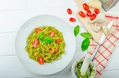 Spinach Tagliatelle With Basil Pesto And Mini Tomatoes