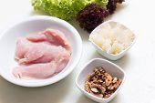 Raw Turkey Breast, Walnut And Pomelo