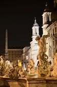 Beautiful Fountain of Neptune on Piazza Navona by night in Rome, Italy