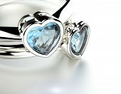 Ring with Blue topaz or aquamarine  heart shape. Jewelry background