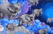Street art Montreal flying elephants