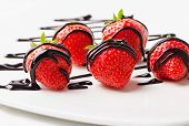 Strawberries Dipped In Chocolate Sauce On White Plate.
