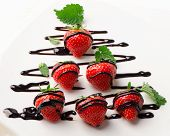 Fresh Strawberries Dipped In Chocolate Sauce On A  Plate.
