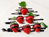 Fresh Strawberries Dipped In Chocolate Sauce On   Plate.