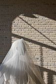 picture of dress mannequin  - Female mannequin in a wedding dress in a shop window - JPG