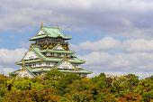 Osaka Castle In Osaka With Autumn Leaves.