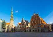RIGA, LATVIA - SEPTEMBER 30: House of the Blackheads and St. Peter's Church at daytime on September 30, 2014 in Riga, Latvia