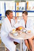 pic of thermal  - Woman and man eating snack with coffee and cake in thermal spa - JPG