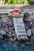 stock photo of bollard  - Red bollard on the coast of a harbor - JPG