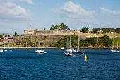 Sailboats Moored Beneath French Fort