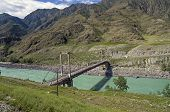 Old Abandoned Bridge Over The River Katun, Altai, Russia.