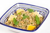 Turkish bulgur wheat salad, known as kisr, made with mint, cucumber,  lemon, romato and parsley,