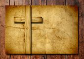 pic of religious  - Vintage old grungy paper banner with a Christian religious cross over ancient wood background for religion or faith designs - JPG