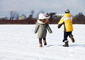 happy little kids running in field