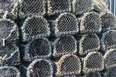 Lobster Pots Stacked On The Quay In Padstow, Cornwall, England Uk