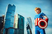 Boy dressed as Captain America in city