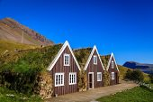 Row of three traditional Icelandic turf houses